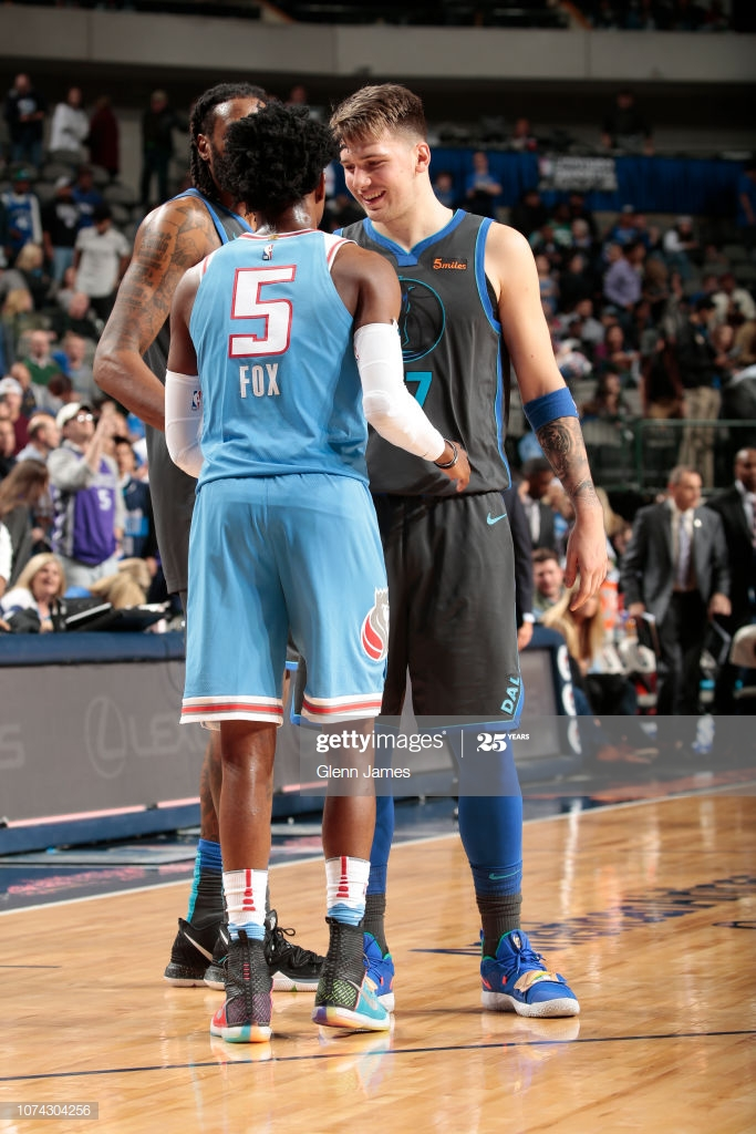 DeAaron Fox of the Sacramento Kings and Luka Doncic of the Dallas 683x1024