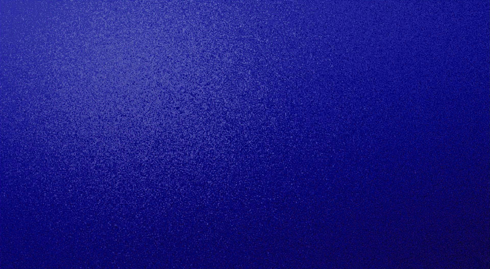 Dark blue/royal blue textured speckled desktop background wallpaper
