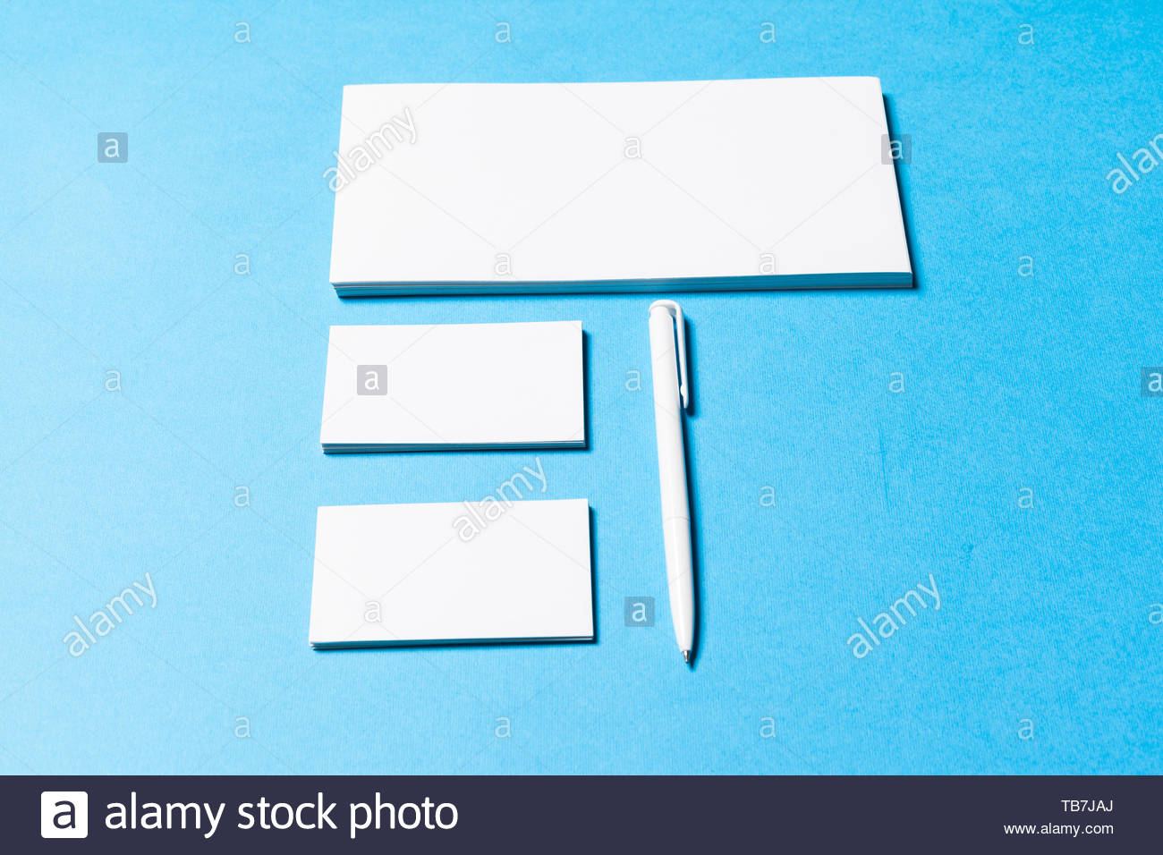 blank office objects organized for company presentation on blue 1300x956