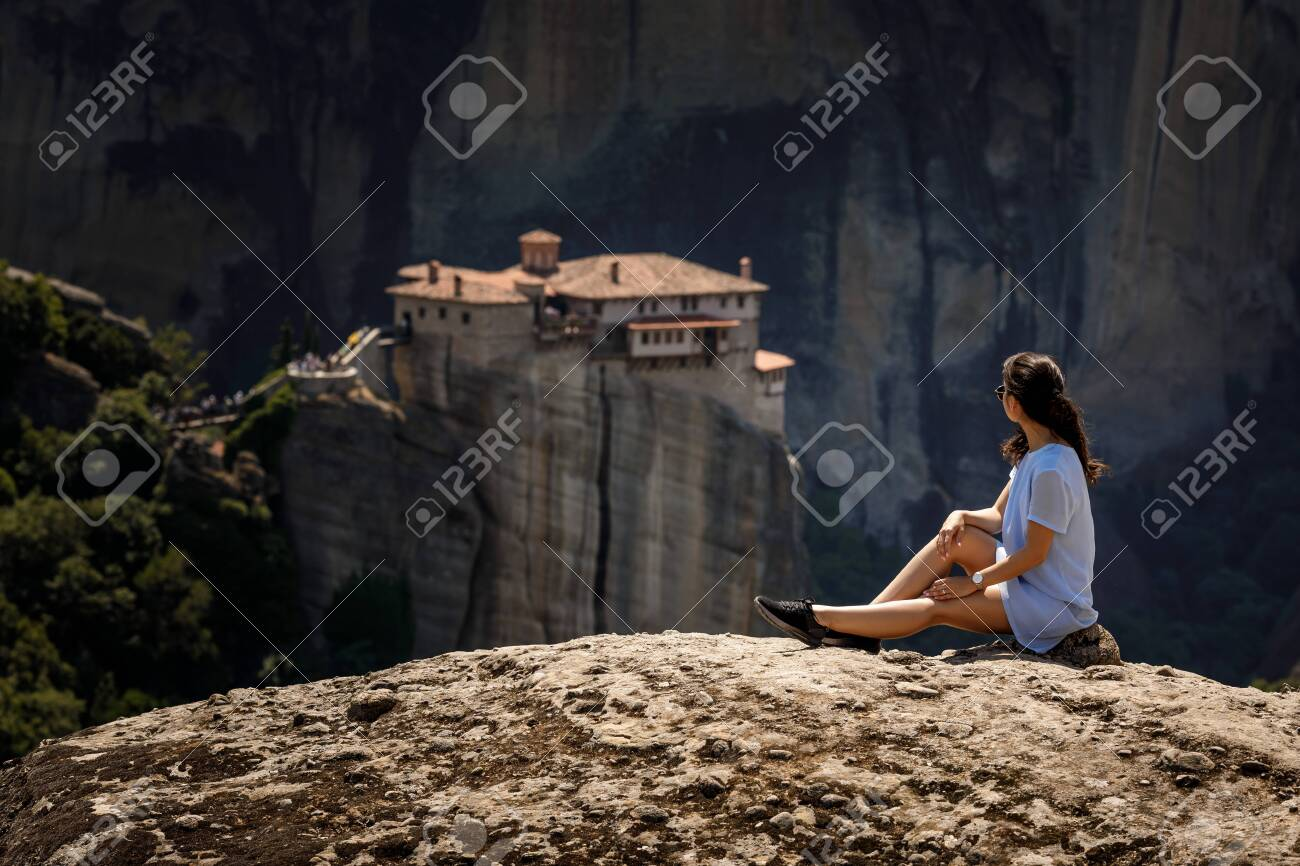 Tourist Woman Sitting On The Top Of Mountain On Beautiful Scenic 1300x866