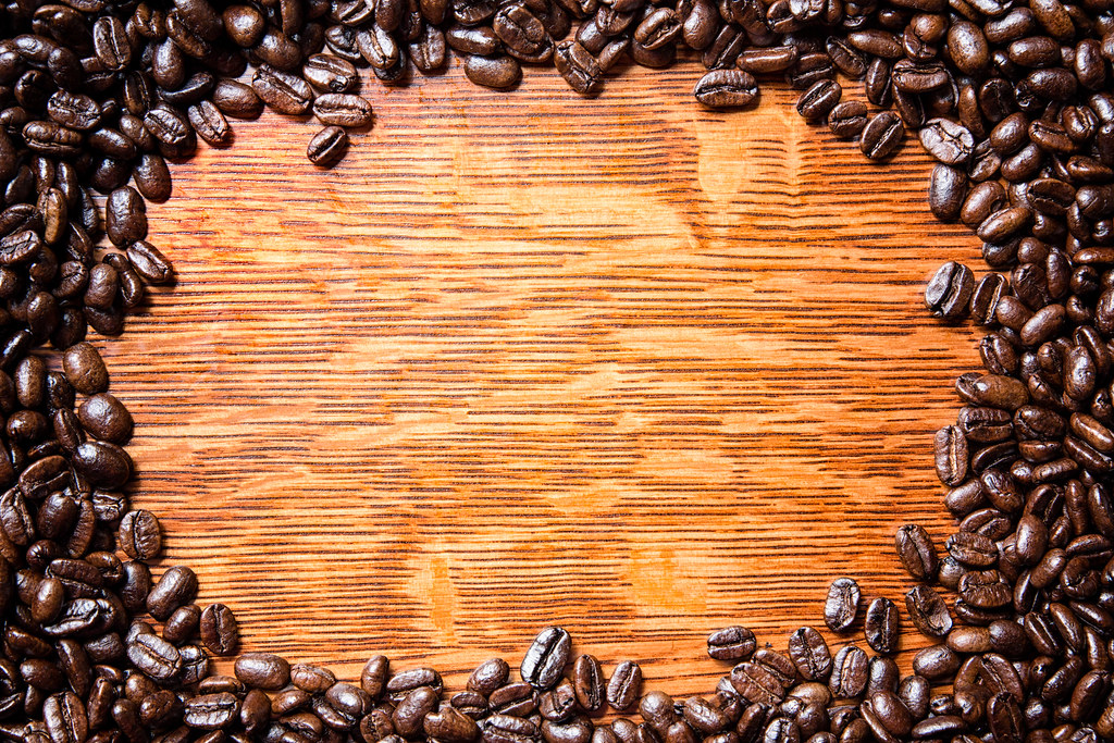 Coffee Background Whole coffee beans arranged around an oa Flickr 1024x683