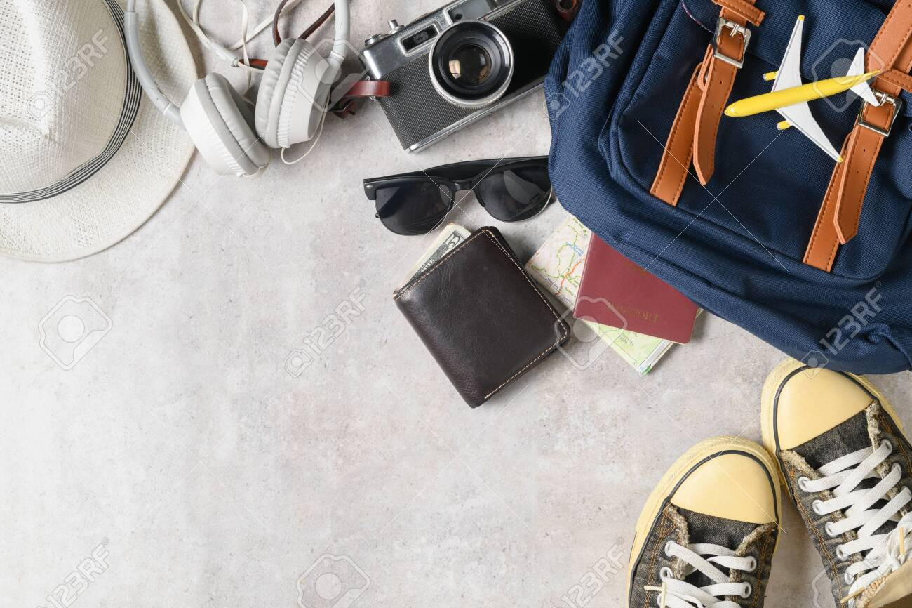 Prepare Backpack Accessories And Travel Items On Marble Background 1300x866