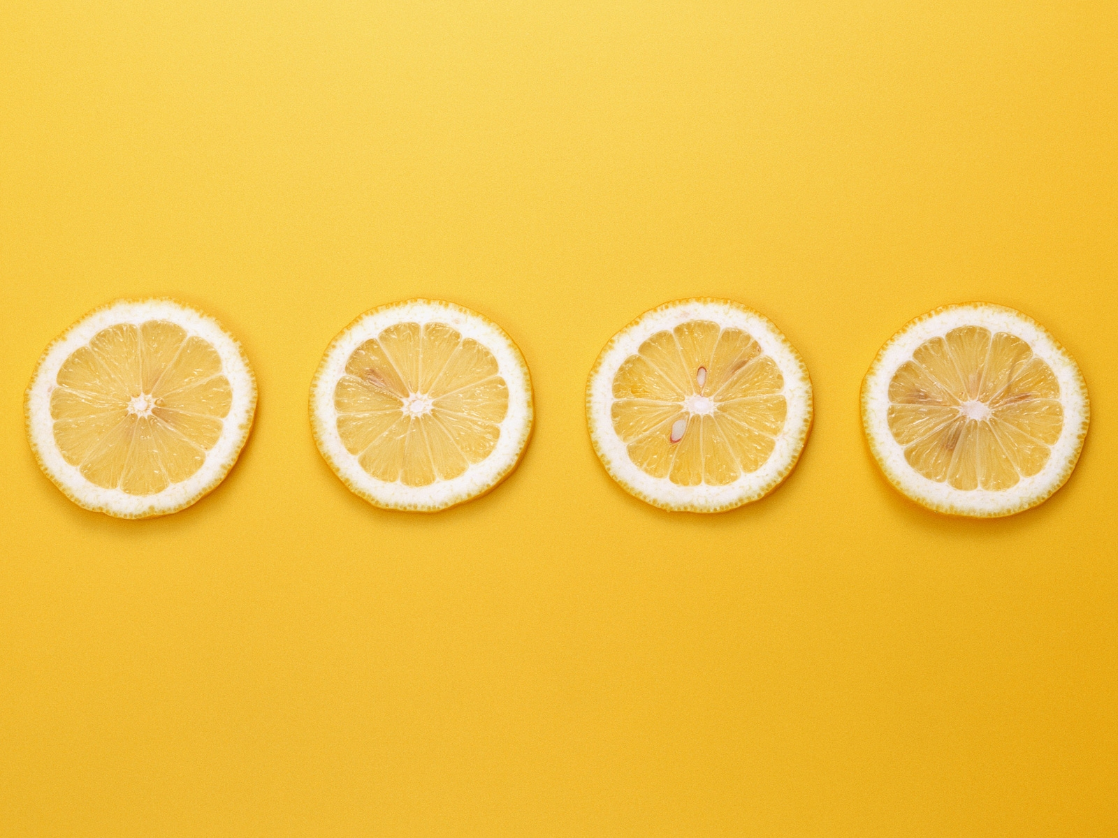 Cute Fruits Wallpaper 4 Lemons in a Line Yellow Background 1600x1200