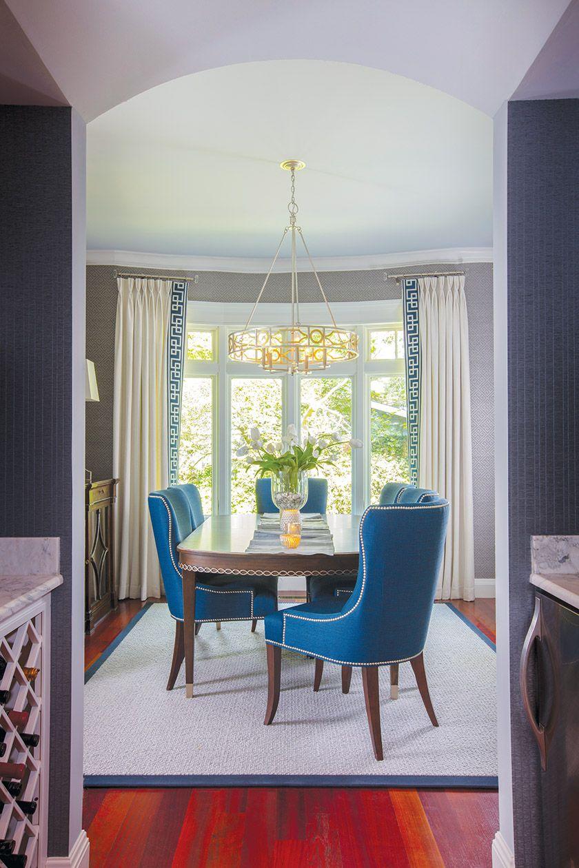 A dining room boasts geometric grass cloth wallpaper from Thibaut 840x1260