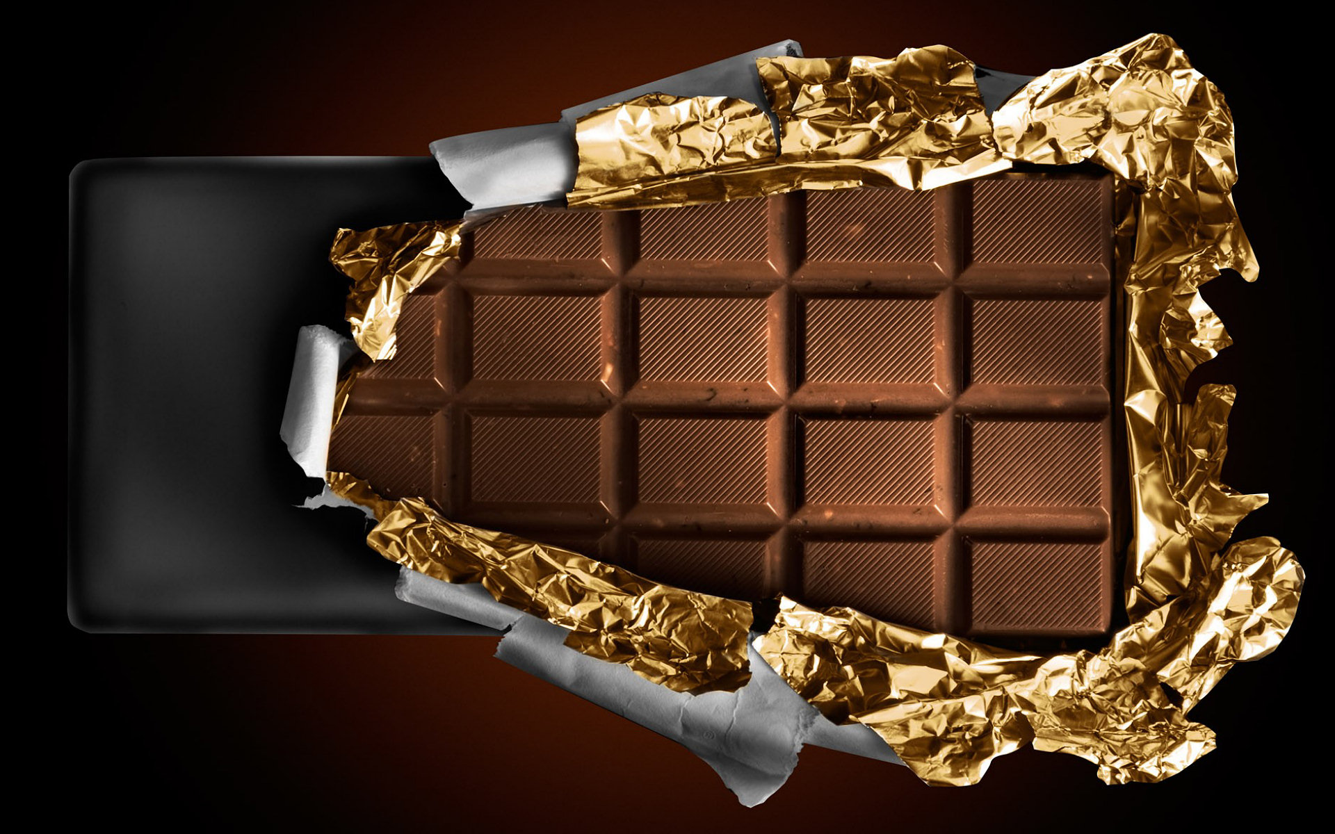 unwrapping a chocolate bar Wallpaper Background 29929 1920x1200