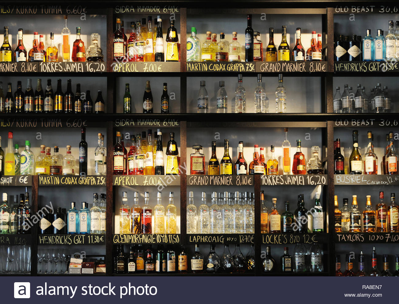 Cocktail Bar with many Bottles Background Stock Photo 230068531 1300x992