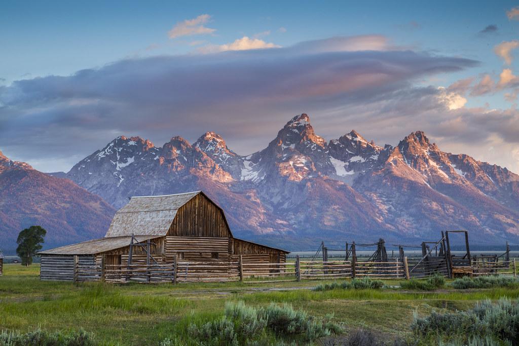 Barn at Mormon Row With Grand Teton as Background   Sunris Flickr 1024x683