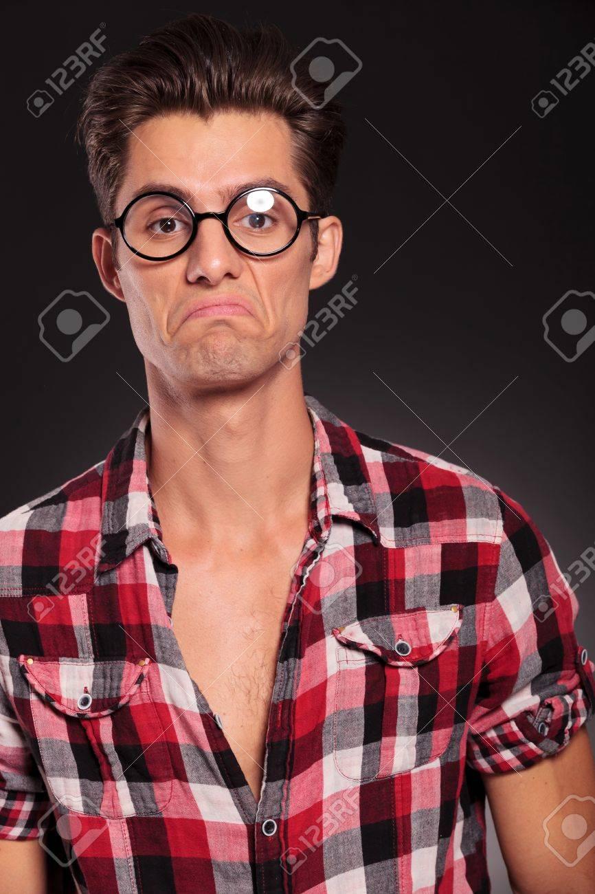Portrait Of Ignorant Casual Man Wearing Glasses On Black Studio 866x1300