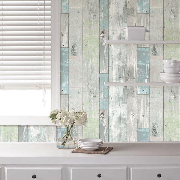 USING PEEL AND STICK WALLPAPER TO DRESS UP BUILT IN SHELVES Refined 600x600