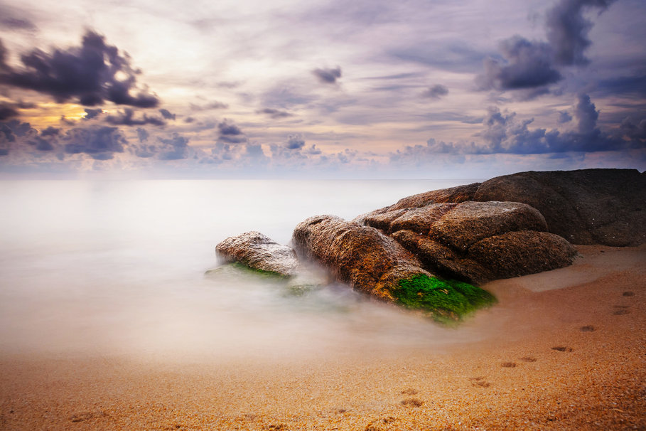 Sky clouds sea beach rocks traces of sand wallpaper 909x606