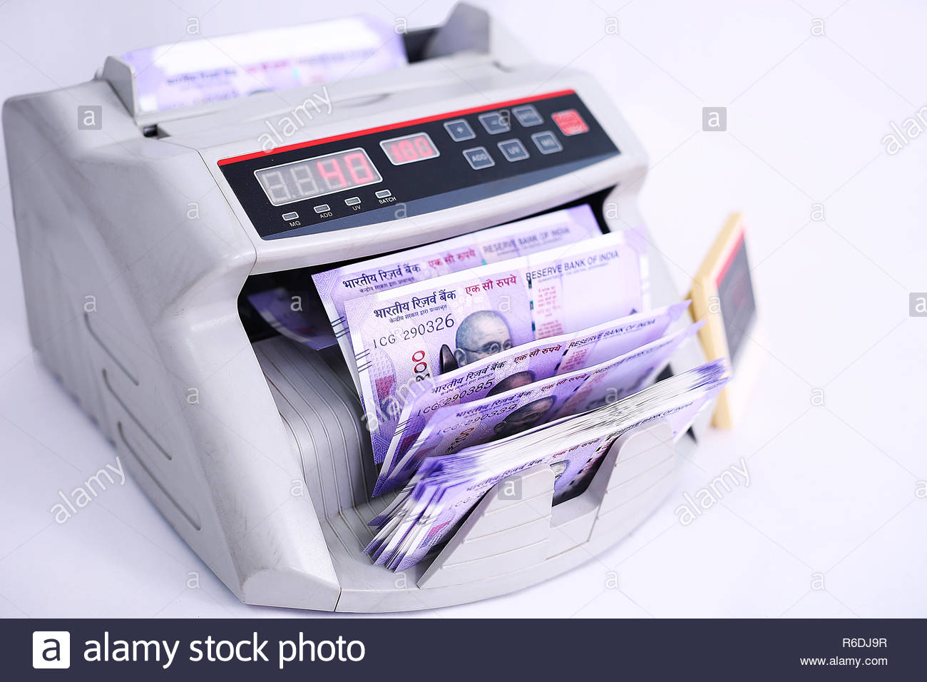 Counting currency in the money counting machine Isolated on the 1300x956