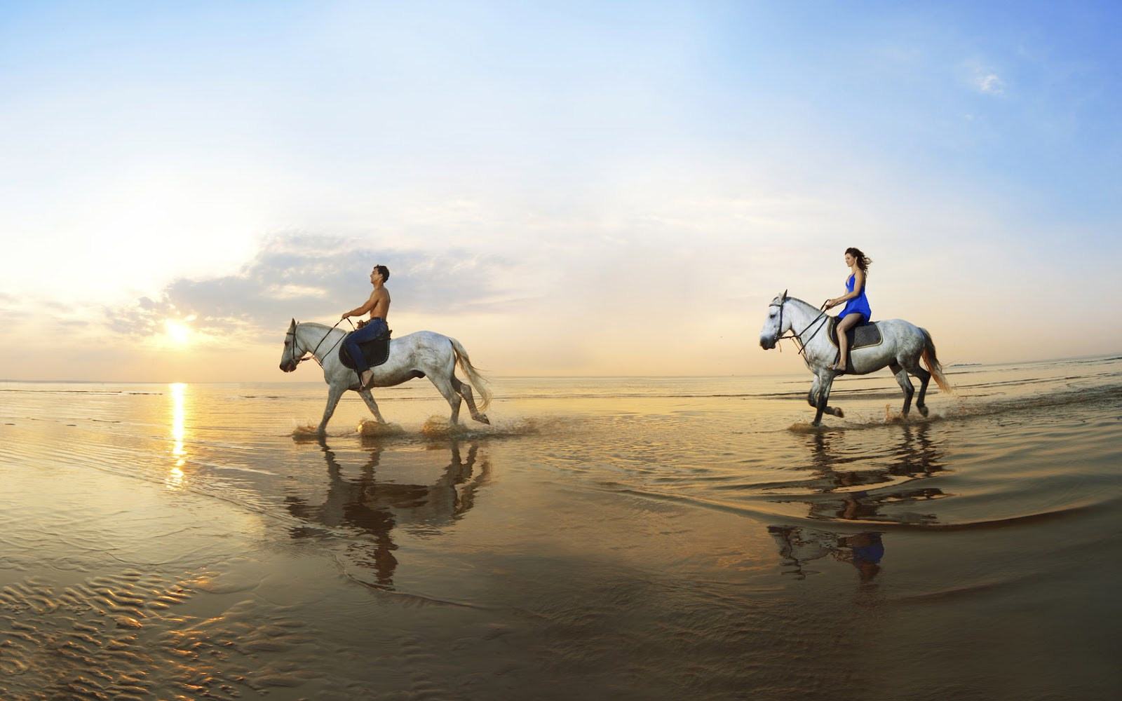 HD horse wallpaper with two people horseback riding on the beach HD 1600x1000