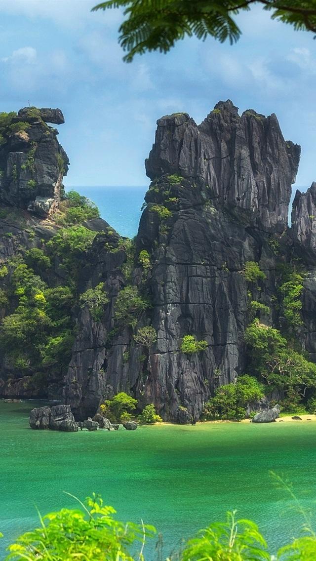 New Caledonia Pacific ocean island trees cliff beach sea 640x1136