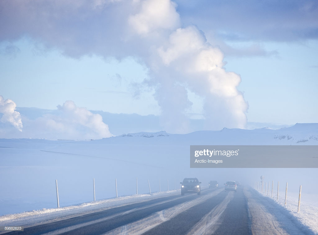 Winter Road Geothermal Steam In Background Stock Photo   Getty Images 1024x757