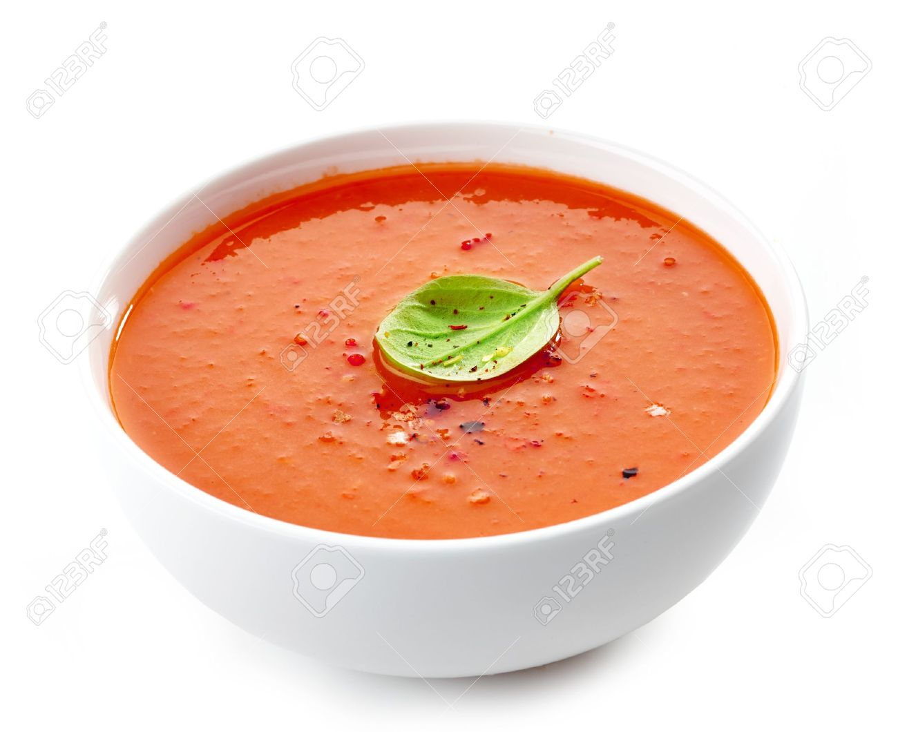 Bowl Of Tomato Soup On A White Background Stock Photo Picture And 1300x1060