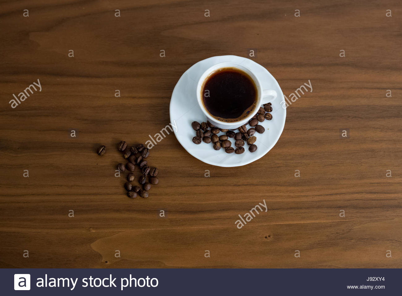Saved coffee in a cup with a wooden background green coffee 1300x956