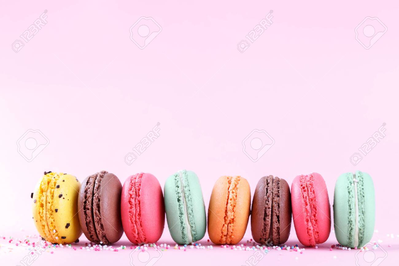 Colorful French Macarons On Pink Background Traditional Desert 1300x866