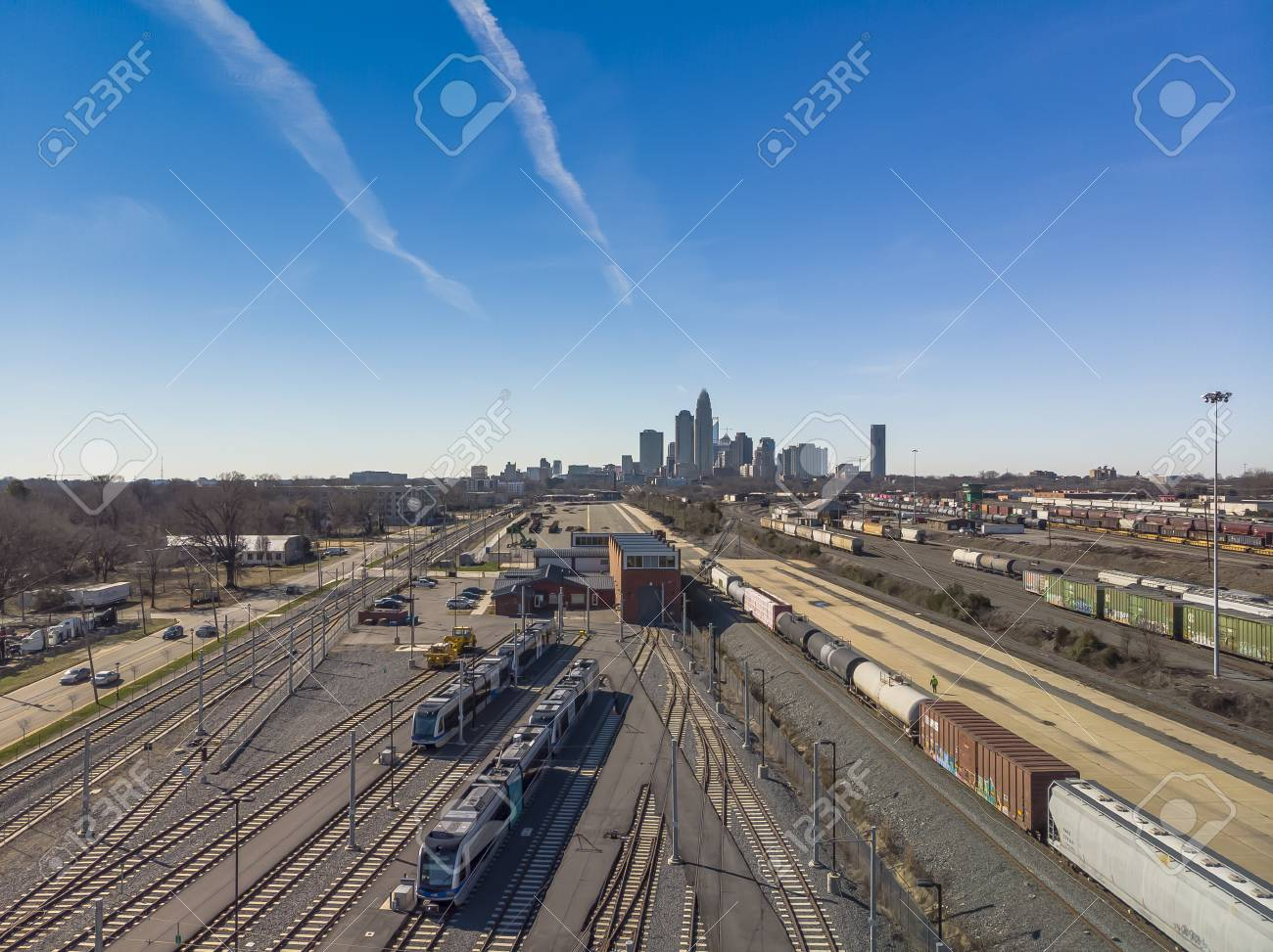 View Of A Train Yard With The City Of Charlotte NC In The 1300x973