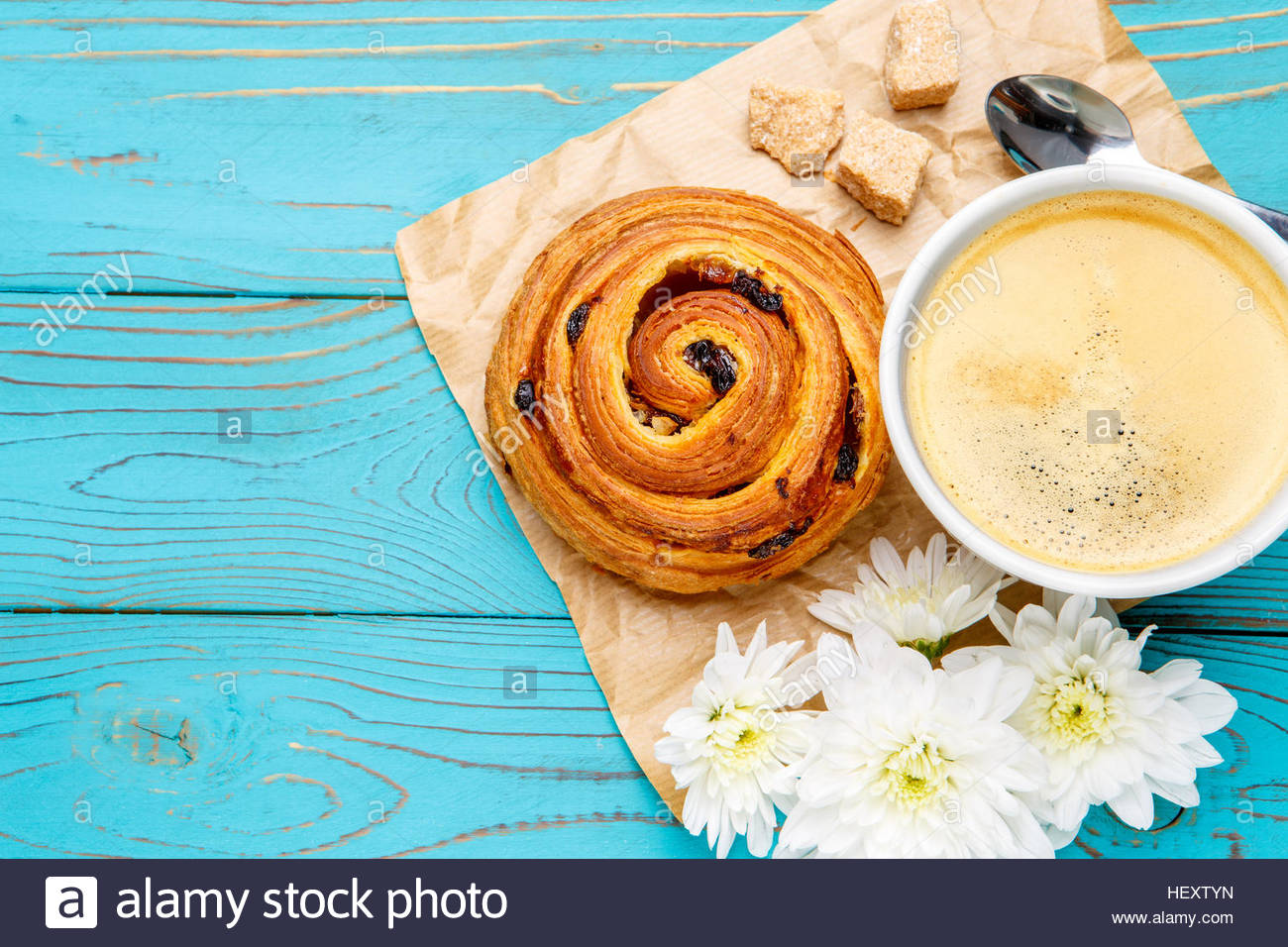 fresh cinnabon and coffee on wooden background Stock Photo 1300x956