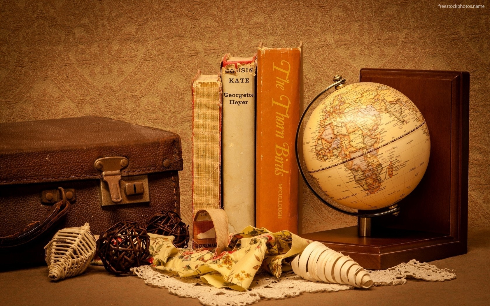 Download Stock Photos of books world globe suitcase wallpaper images 1680x1050