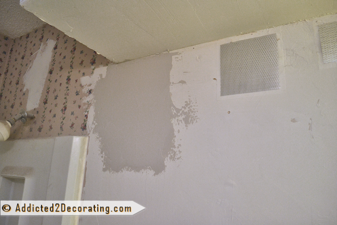 to fix a hole in drywall   the easy way   using a drywall repair patch 690x460