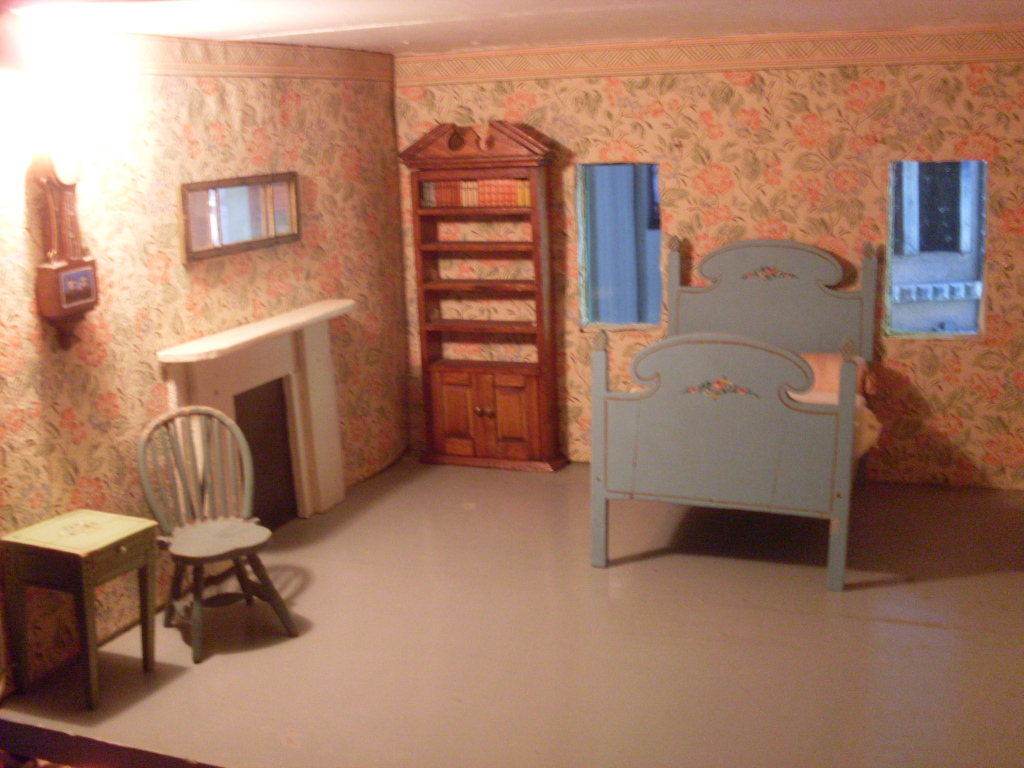 This bedroom features an antique hand blocked wallpaper and border 1024x768