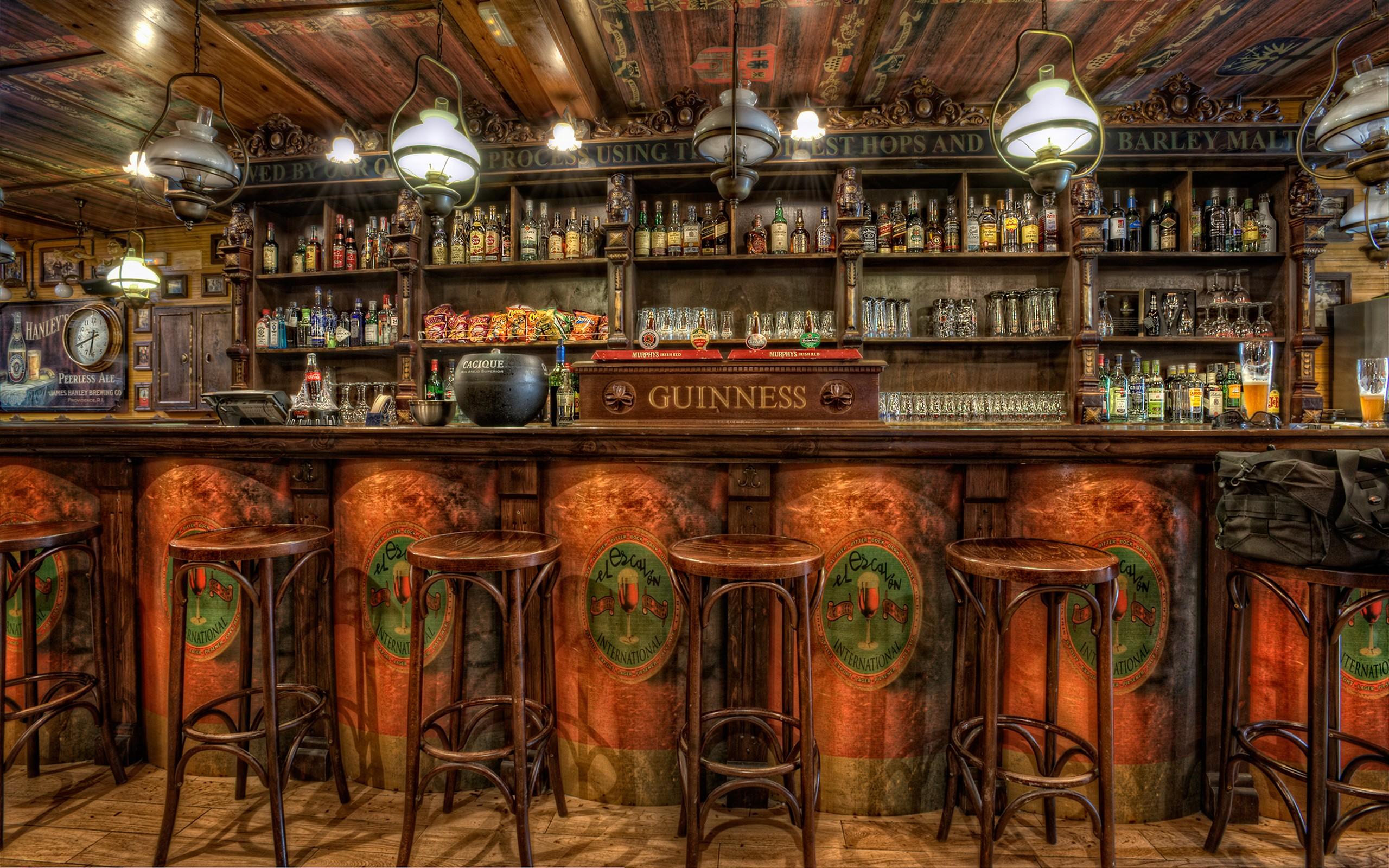 Wallpaper Beautiful wooden bar counter shelves a lot of alcohol 2560x1600