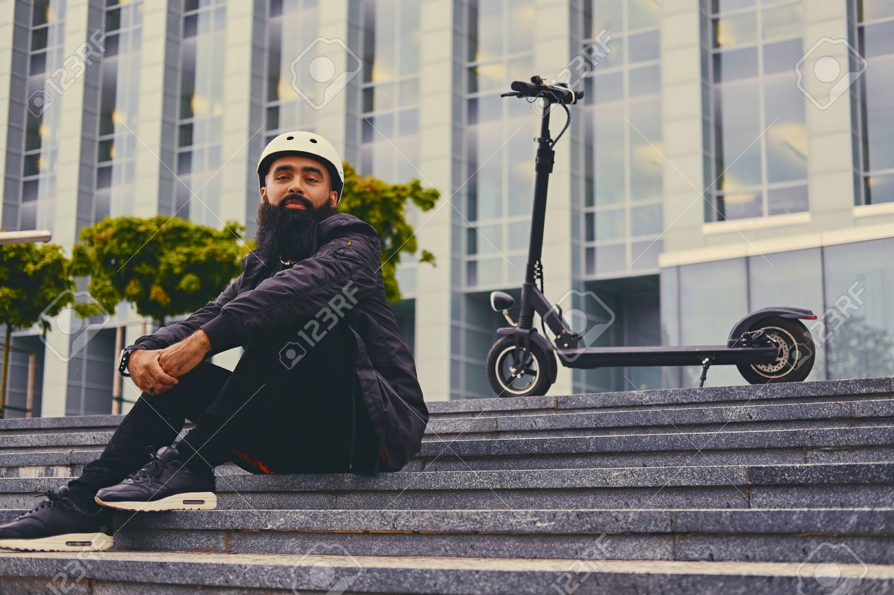 Stylish Bearded Male On A Step Over Electric Scooter Background 1300x866