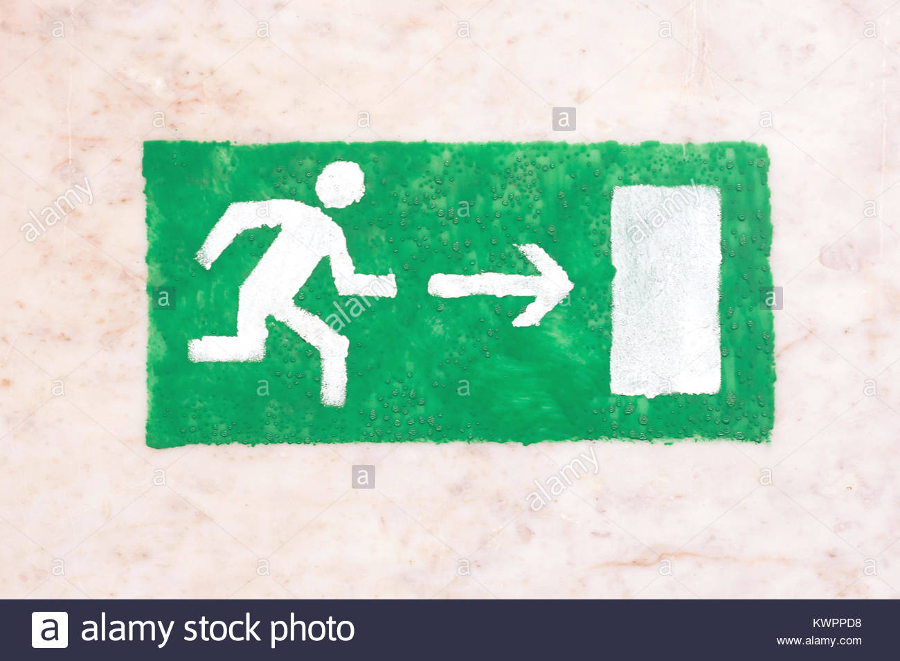 Emergency exit sign green on a light background visitor safety 1300x955