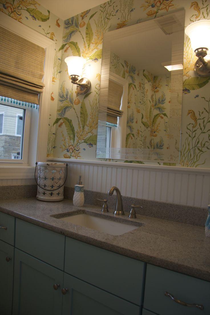Beach bathroom with wallpaper and Roman shade granite countertop 736x1104