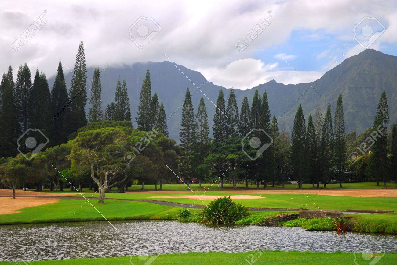 Tranquil Setting Of A Golf Course With A Mountain Background 1300x870