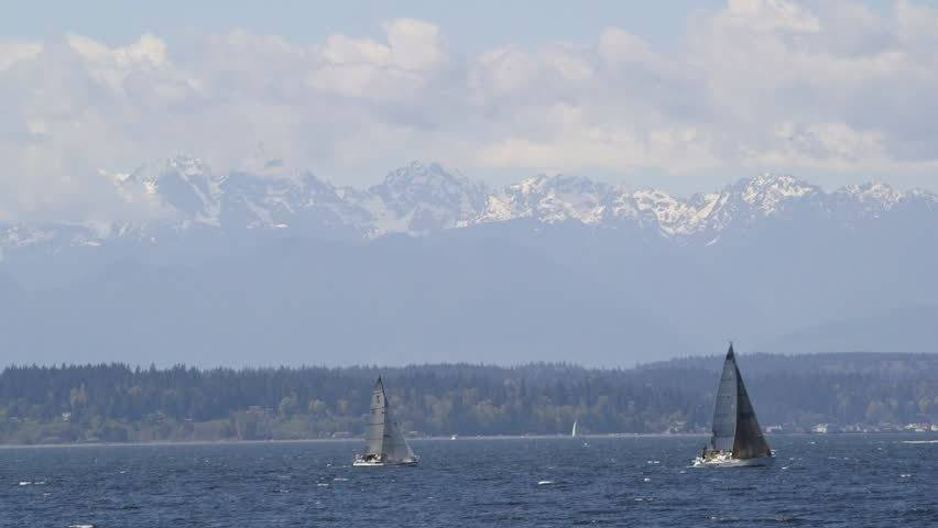 Sailboats in Puget Sound Olympic Mountains in Background   HD stock 852x480