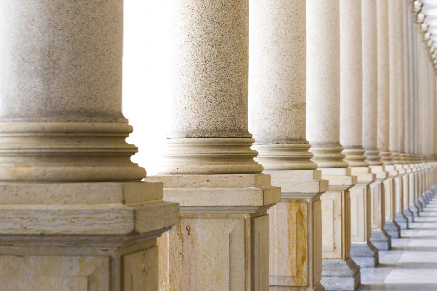 Colonnade row of classical stone columns background with copy 1500x1000