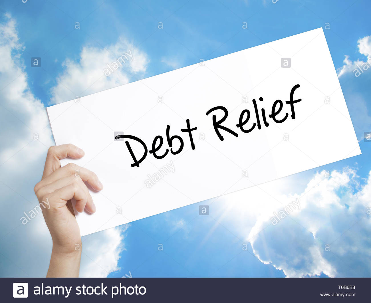 Debt Relief Sign on white paper Man Hand Holding Paper with text 1300x1062