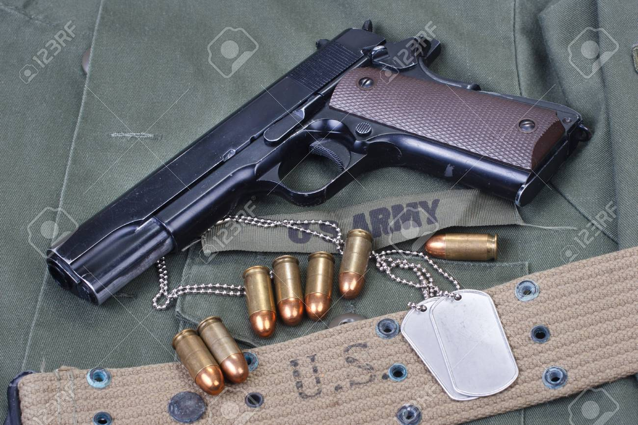 Government M1911 With US ARMY Uniform Texture Background Stock 1300x866