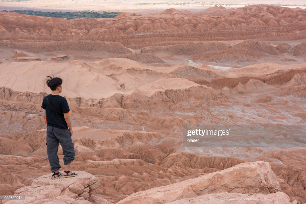 Single Person On Mountaintop Moon Valley In Background Stock Photo 1024x683
