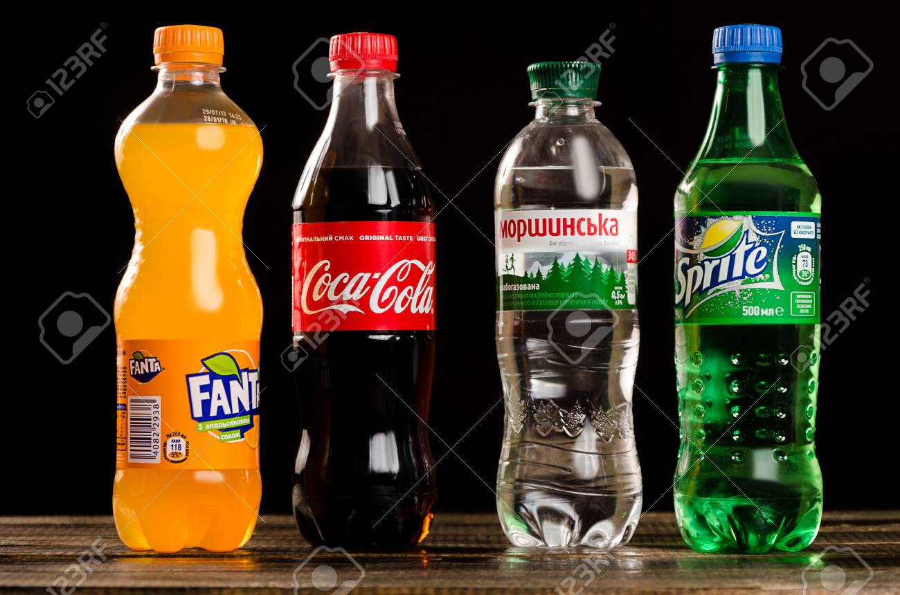 Coca Cola Fanta Sprite And Morshynian On A Dark Background Stock 1300x860