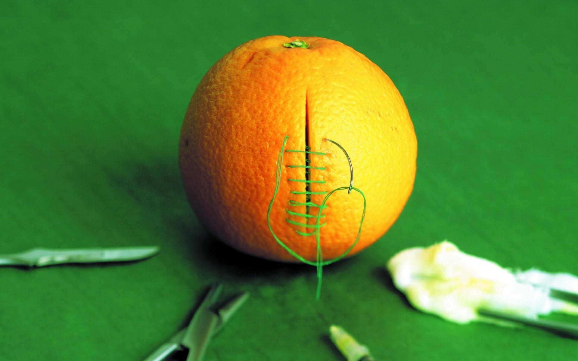 Orange funny medical stitch cutting green background wallpaper 1920x1200