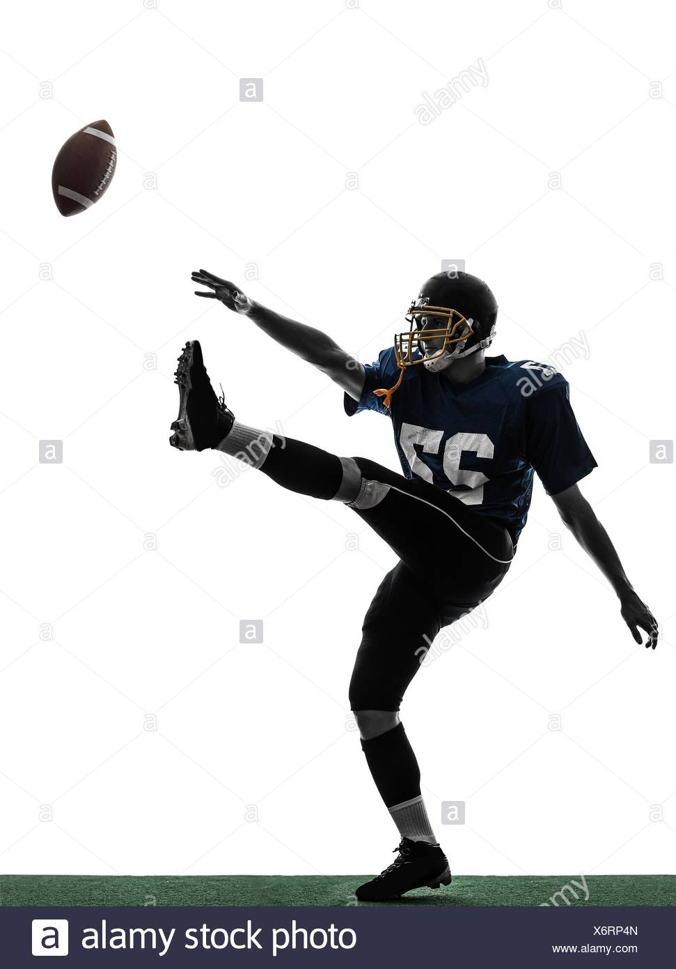 one caucasian american football player man kicker kicking in 971x1390