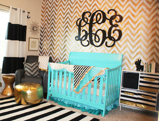 gold stenciled accent wall in a nursery using the Ikat Zig Zag 550x419