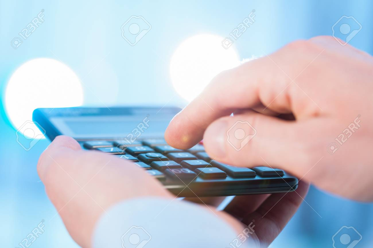 Businessman Holding A Calculator And Counting Blue Background 1300x866