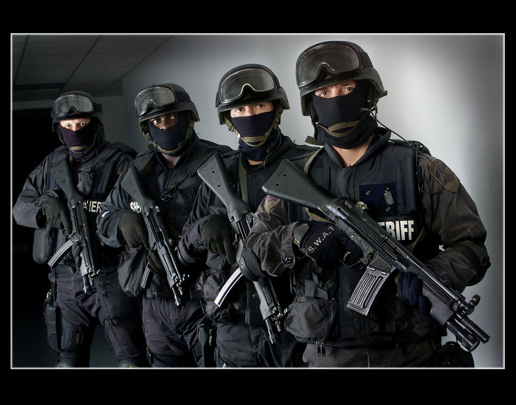 Sheriffs SWAT team members right to left  foreground to background 1650x1296