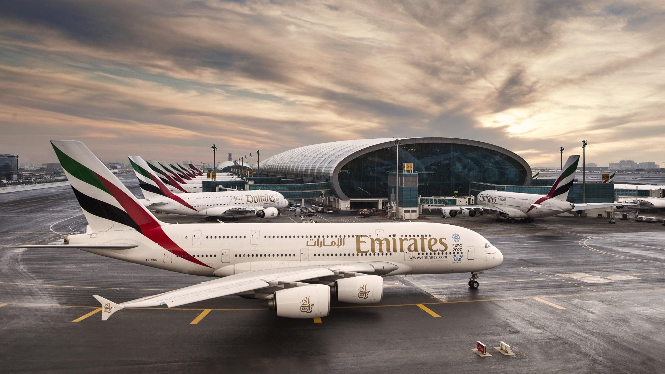 White Fly Emirates airplane on asphalt road HD wallpaper 2560x1440