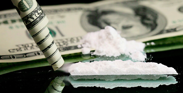 VideoHive Cocaine Snorted Through Rolled 100 Dollar Banknote 2004876 590x300