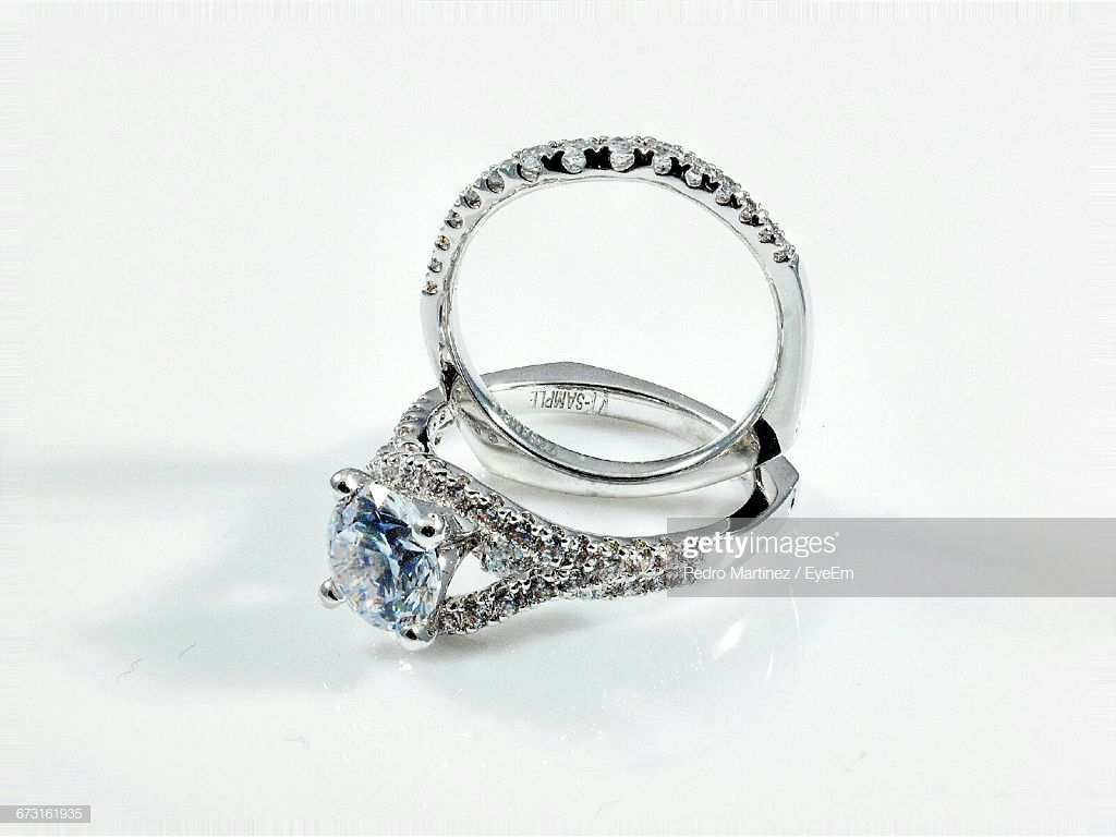 Closeup Of Diamond Rings Against White Background High Res Stock 1024x768