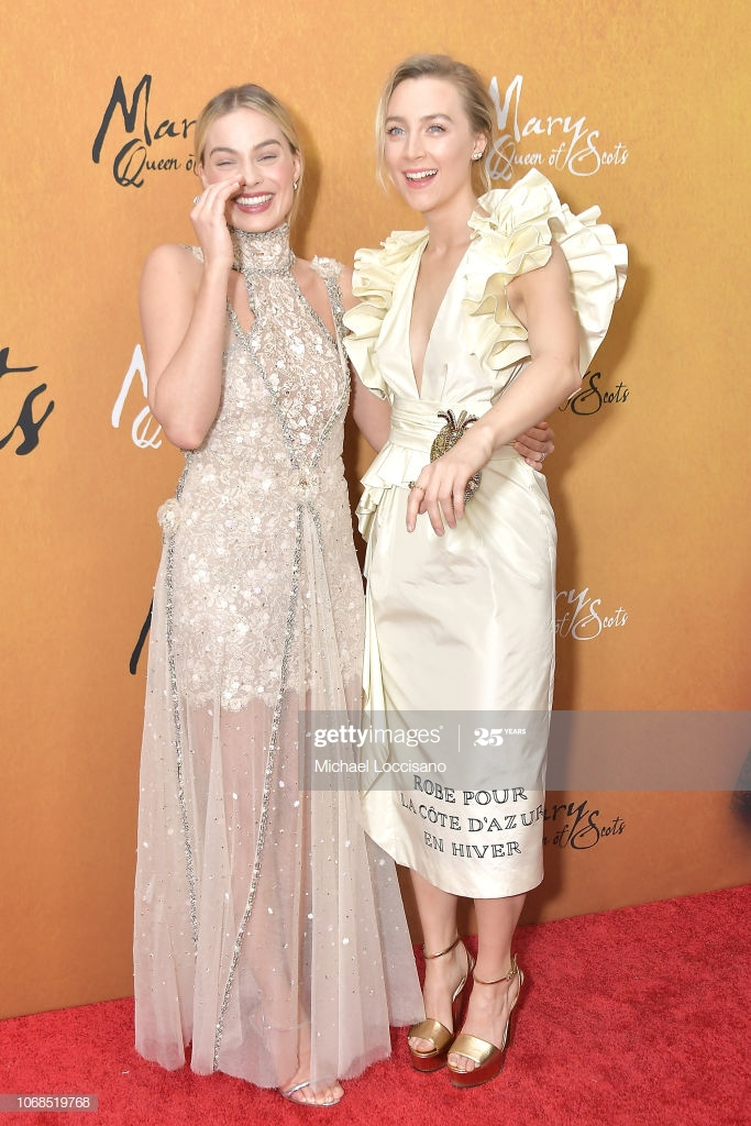 Actresses Margot Robbie and Saoirse Ronan attend the New York 683x1024