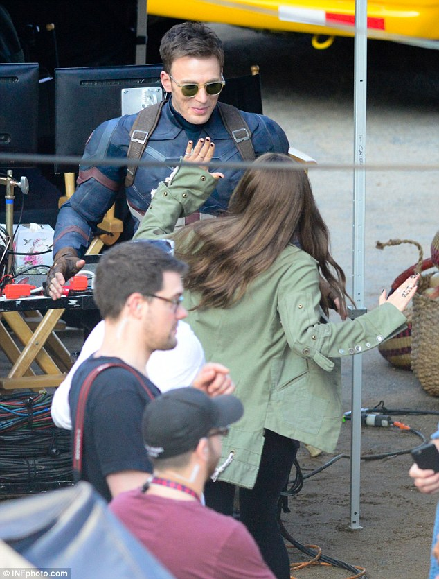 Elizabeth Olsen and Chris Evans on the set of Captain America 634x835