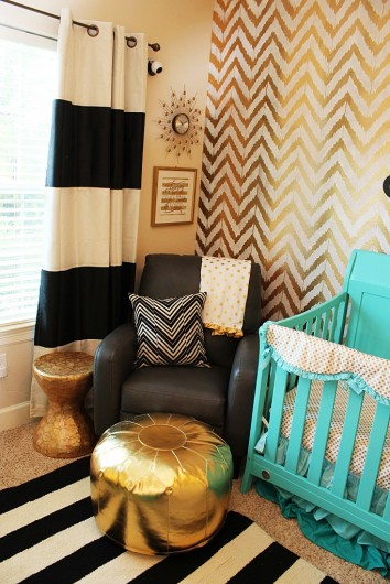 gold stenciled accent wall in a nursery using the Ikat Zig Zag 354x530
