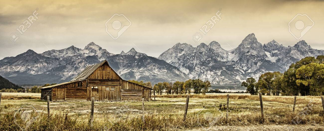 Old Barn With The Grand Tetons In The Background Stock Photo 1300x528