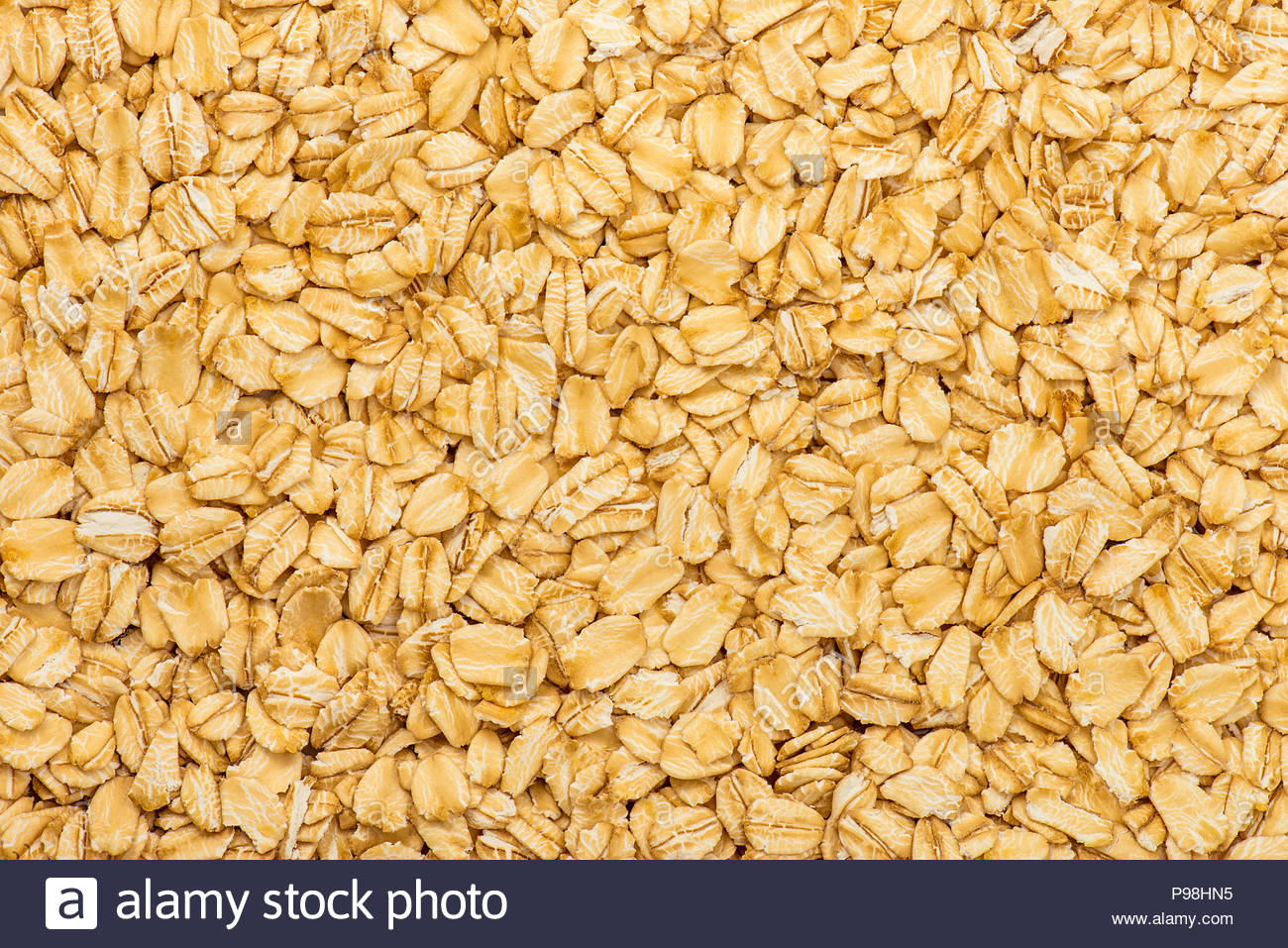 Oatmeal texture Rolled oat flakes background Stock Photo 1300x957